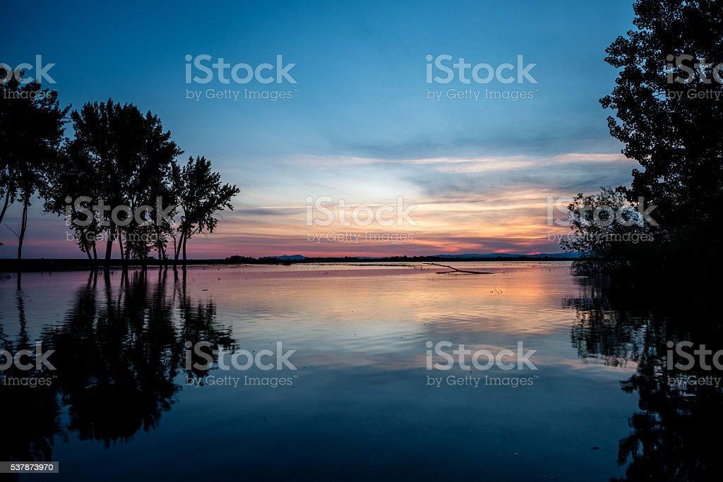 Lake Lowell Idaho sunrise reflection and trees stock photo