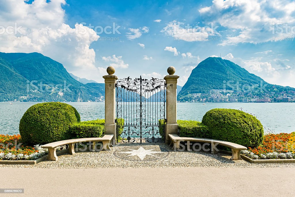 Lake Lugano from city park stock photo