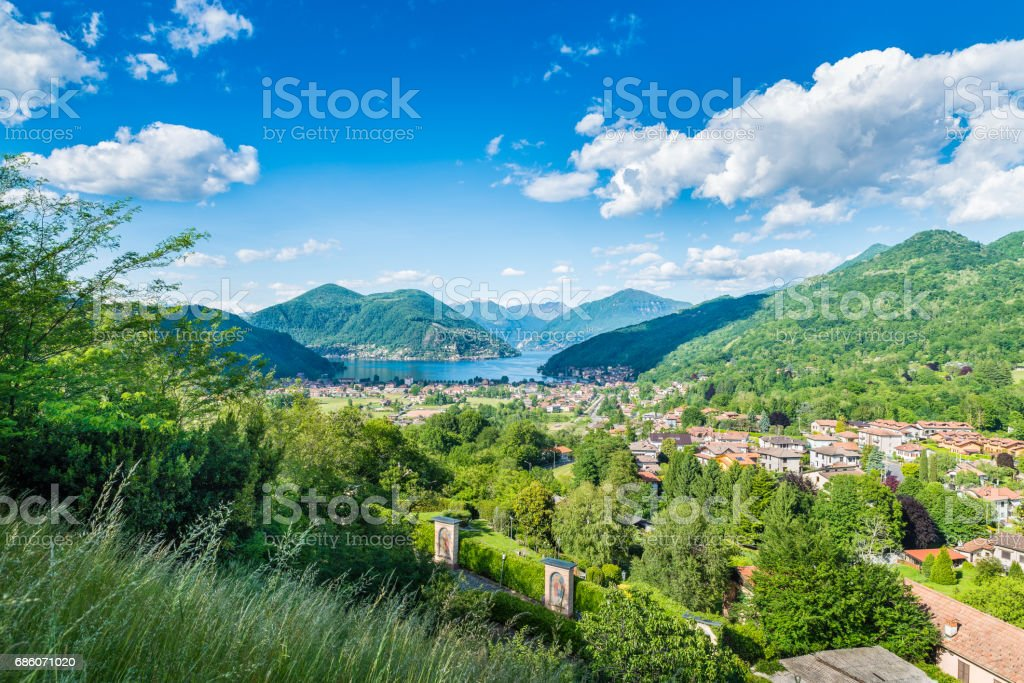 Lake Lugano, Porto Ceresio and Besano (Valceresio), Italy. Picturesque aerial view, in the background the Switzerland with Marcote, Melide, the Alps on a beautiful day with blue sky and white clouds stock photo