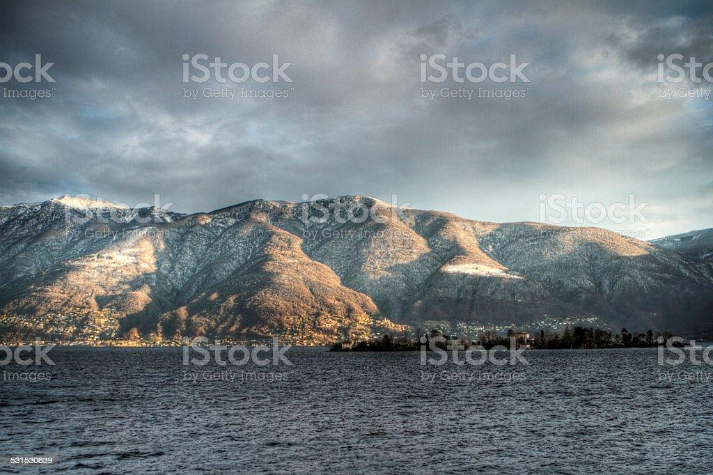 Lake Maggiore and mountains-Winter stock photo