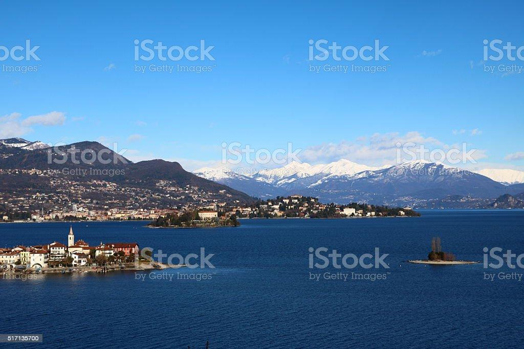Lake Maggiore under blue sky in winter, Piedmont Italy stock photo