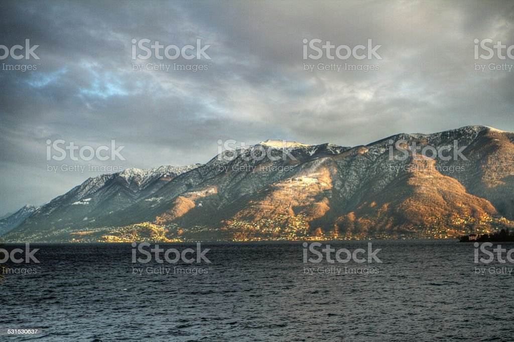 Lake Maggiore with mountains-Winter in Switzerland stock photo