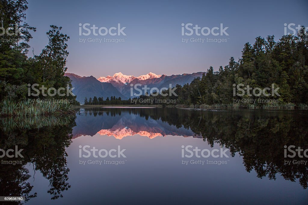 Lake Matheson And The Southern Alps At Dusk stock photo