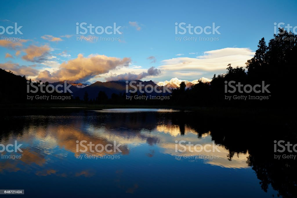 Lake Matheson And The Southern Alps In New Zealand stock photo