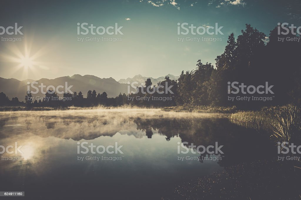 Lake Matheson Nature Panorama at Sunrise, New Zealand stock photo