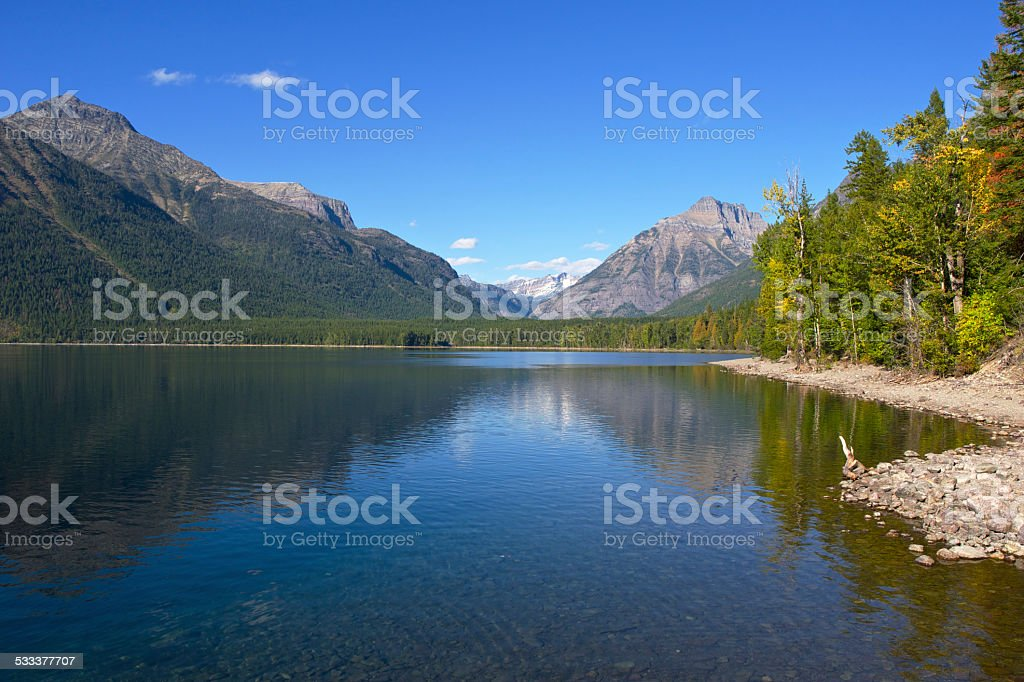 Lake McDonald Glacier National Park Sky Mountains Trees Reflections Shoreline stock photo