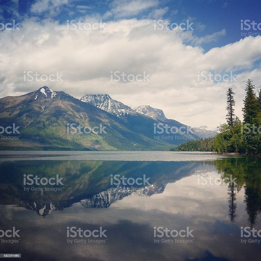 Lake McDonald reflections Glacier National Park Montana USA stock photo
