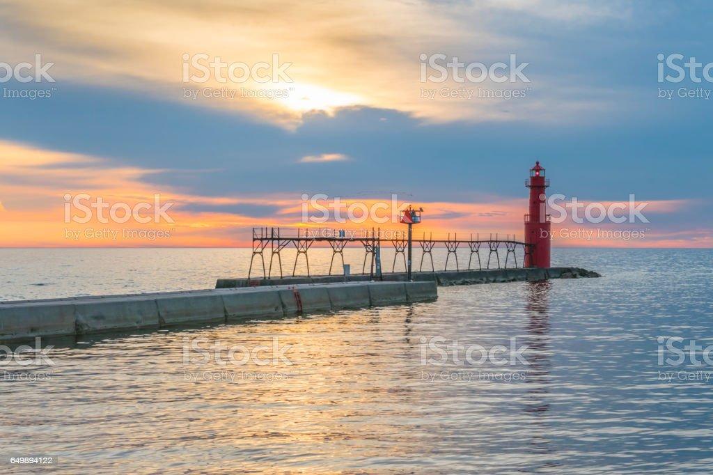 Lake Michigan Sunrise with iconic pier and Lighthouse. stock photo