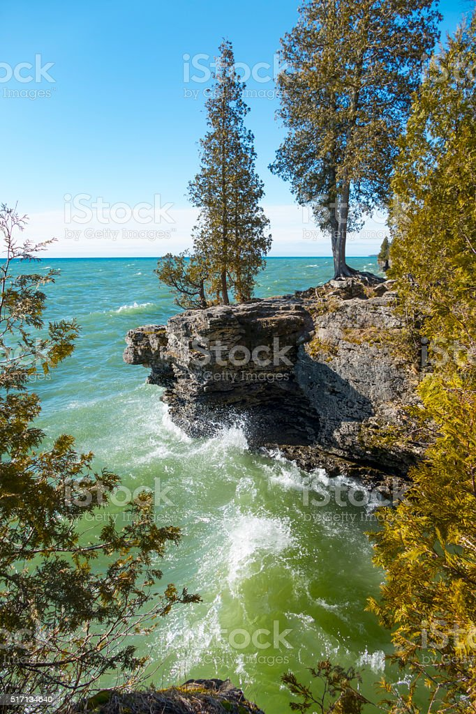 Lake Michigan waves crash on rocky shores, Cave Point, Wisconsin stock photo