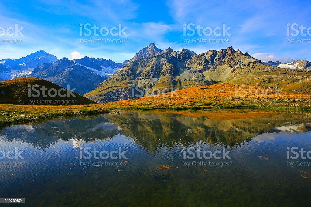 Lake mirrored swiss alps reflection, golden autumn, Zermatt stock photo