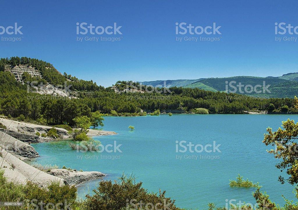 Lake, mountains and trees stock photo