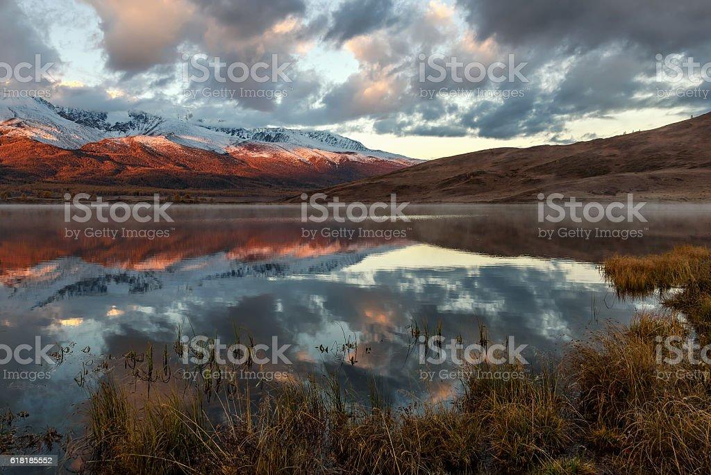 lake mountains reflection snow sunrise stock photo