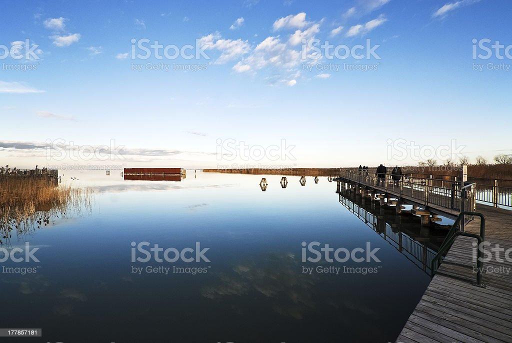 Lake Neusiedlersee with footbridge to an island stock photo