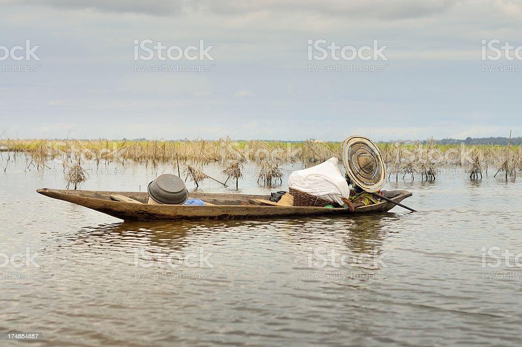 Lake Nokoue Woman In Dugout Canoe stock photo