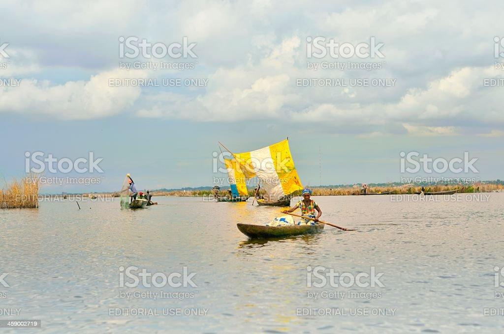 Lake Nokoue Woman Paddling Dugout stock photo