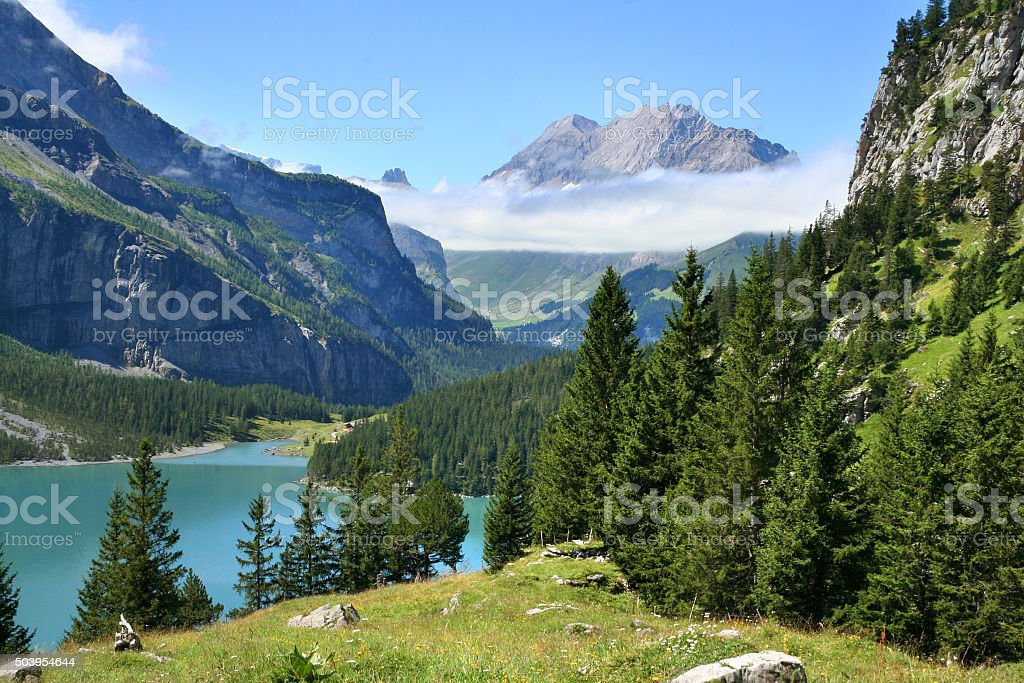 Lake Oeschinensee in the Swiss Alps stock photo