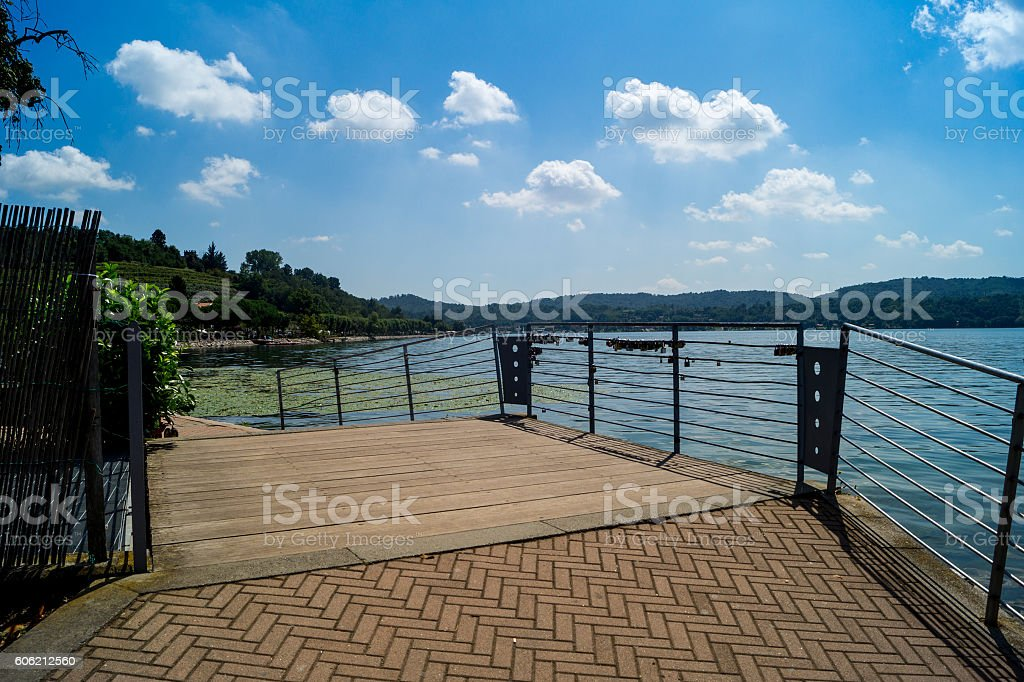 Lake of Viverone panorama with mountains on horizon. stock photo