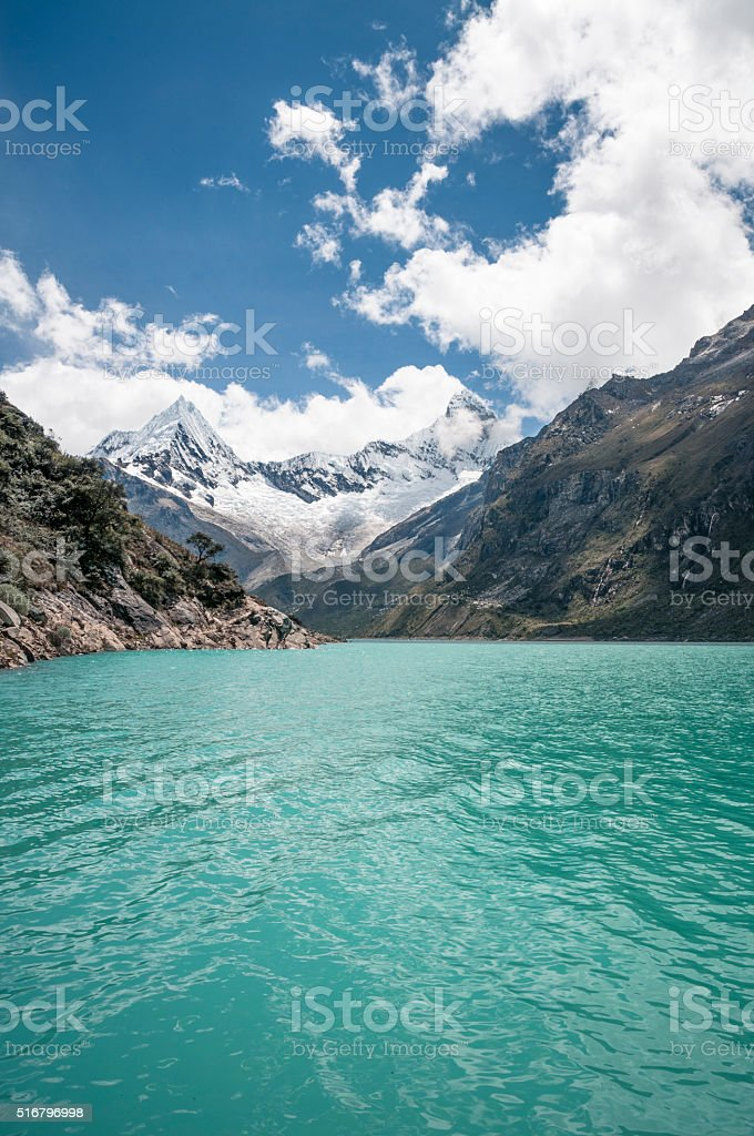 Lake Paron And Pyramid Peak In The Peruvian Andes stock photo