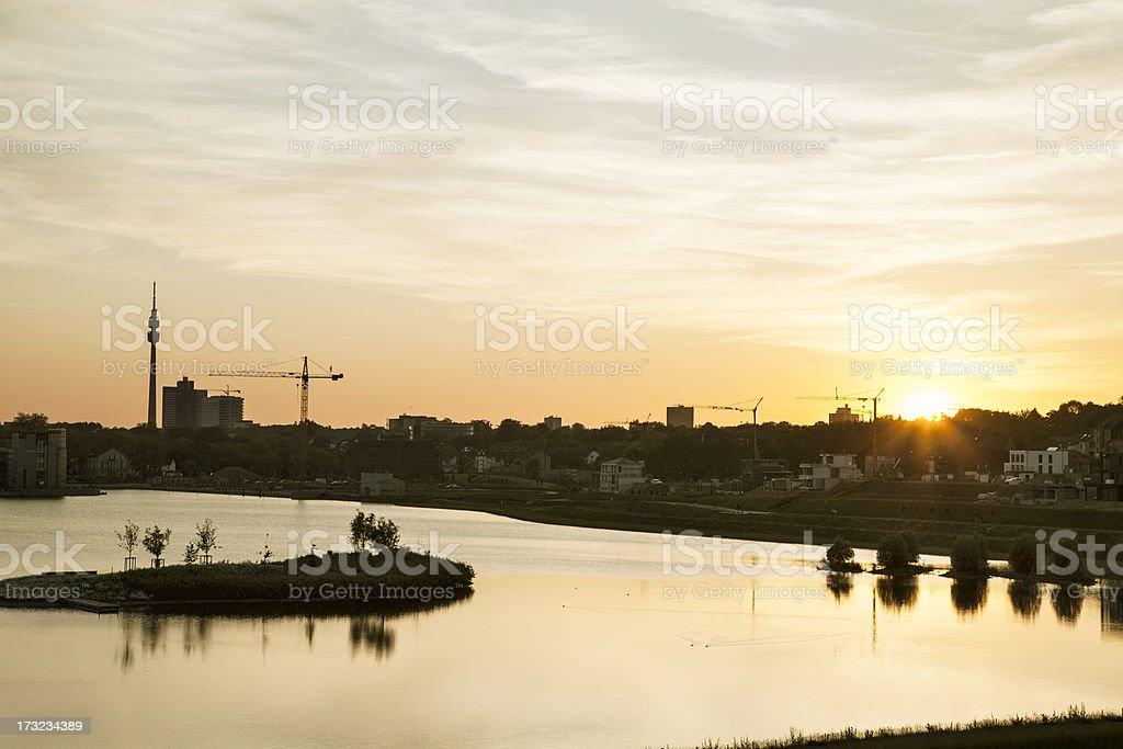 lake phoenix in Dortmund, city skyline at sunset stock photo