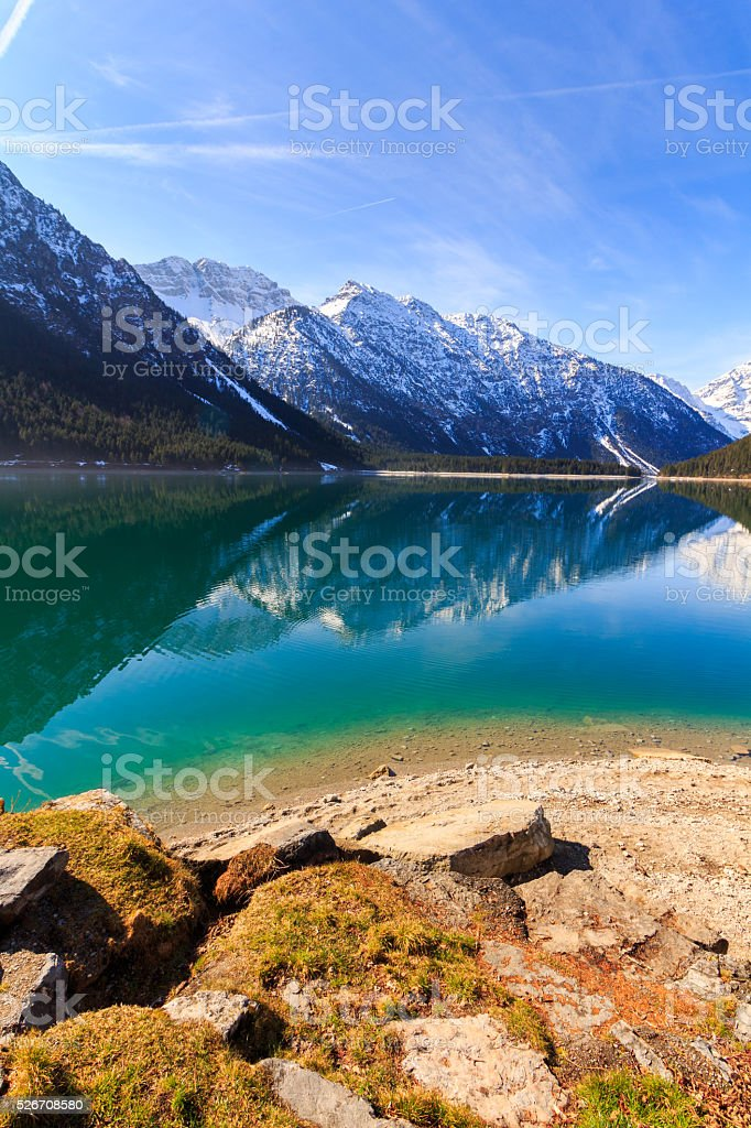 Lake Plansee with mountains reflecting in the water, Tyrol, Austria stock photo