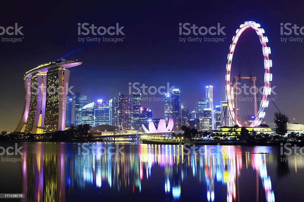Lake reflecting the Singapore city skyline at night stock photo