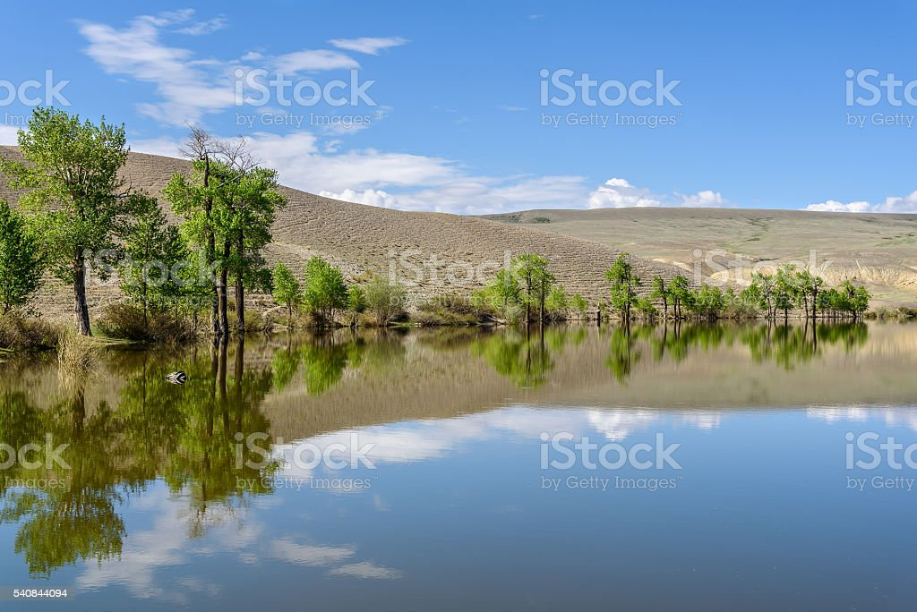lake reflection mountains sky clouds stock photo