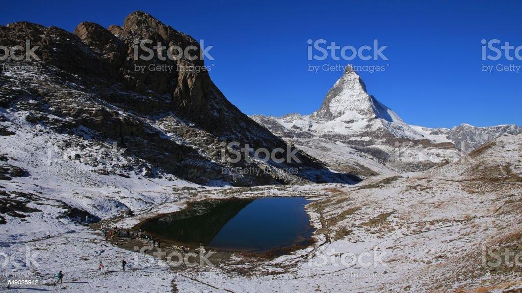Lake Riffelsee and Matterhorn in autumn stock photo