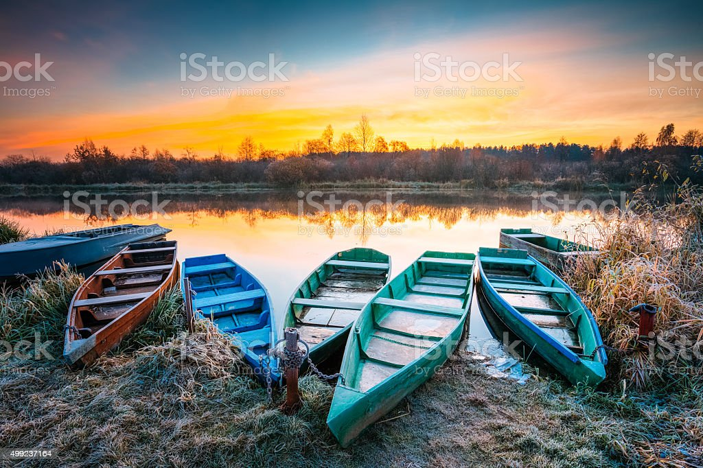 Lake, River and old wooden rowing fishing boat stock photo