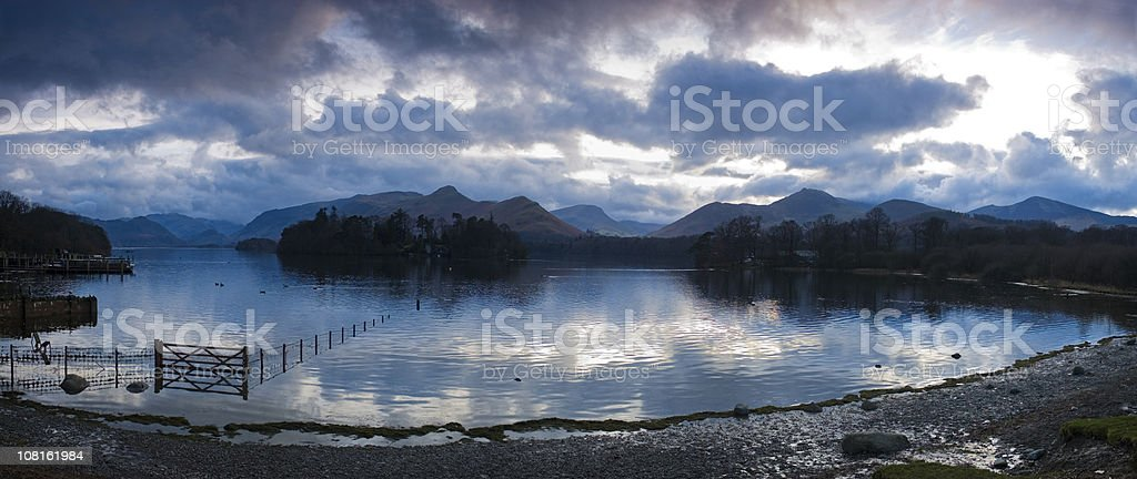 Lake Shore with Dramatic Cloudscape at Twilight stock photo