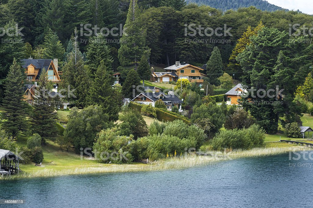 Lake shore with houses royalty-free stock photo