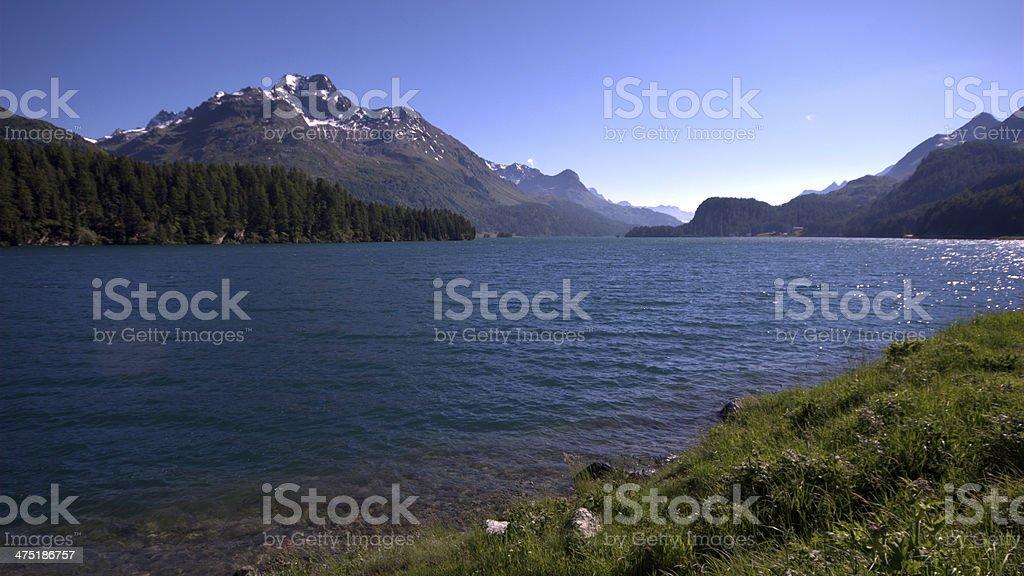 Lake Silvaplana (or Silvaplanersee; Lej da Silvaplauna) royalty-free stock photo