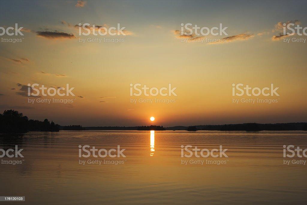 Lake Sunset at Edge of Minnesota Boundary Waters Canoe Area royalty-free stock photo