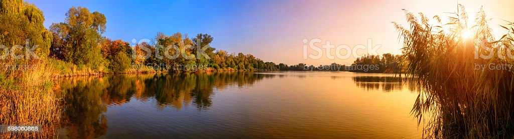 Lake sunset panorama in gold and blue stock photo