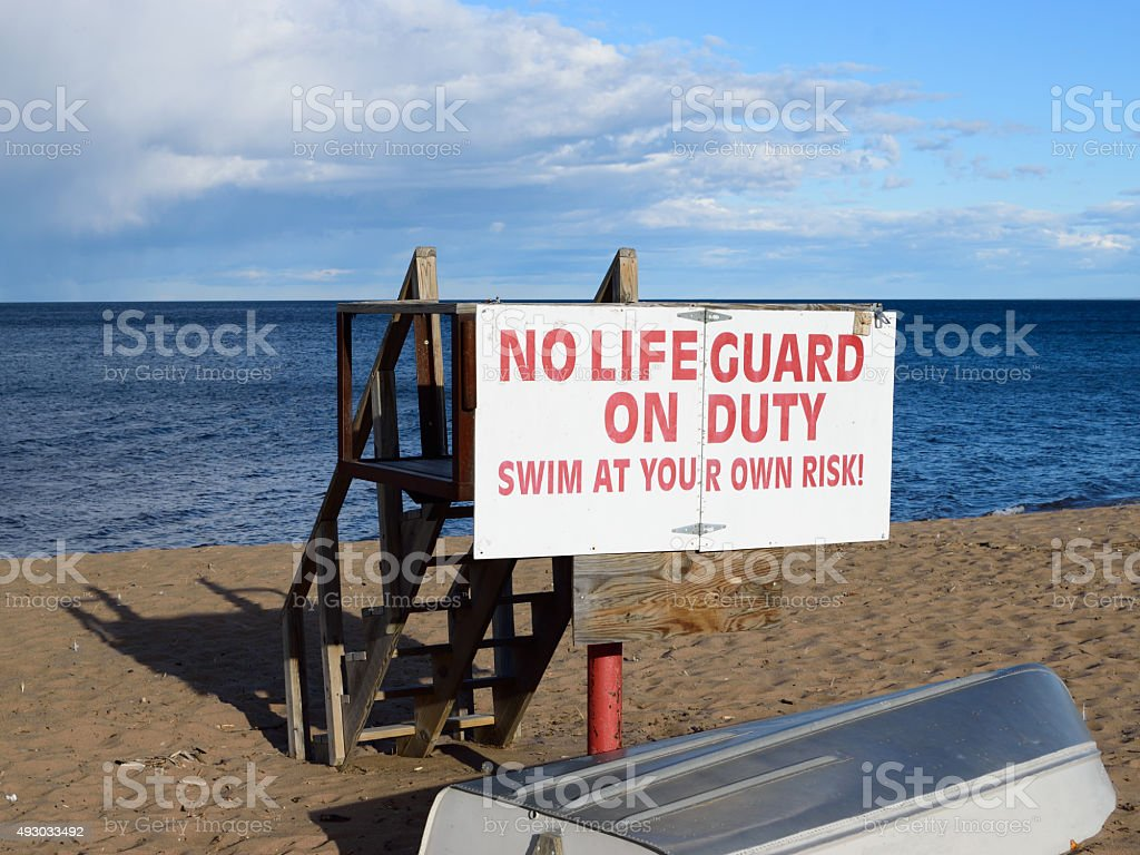 Lake Superior Lifeguard Station and Boat in Fall stock photo