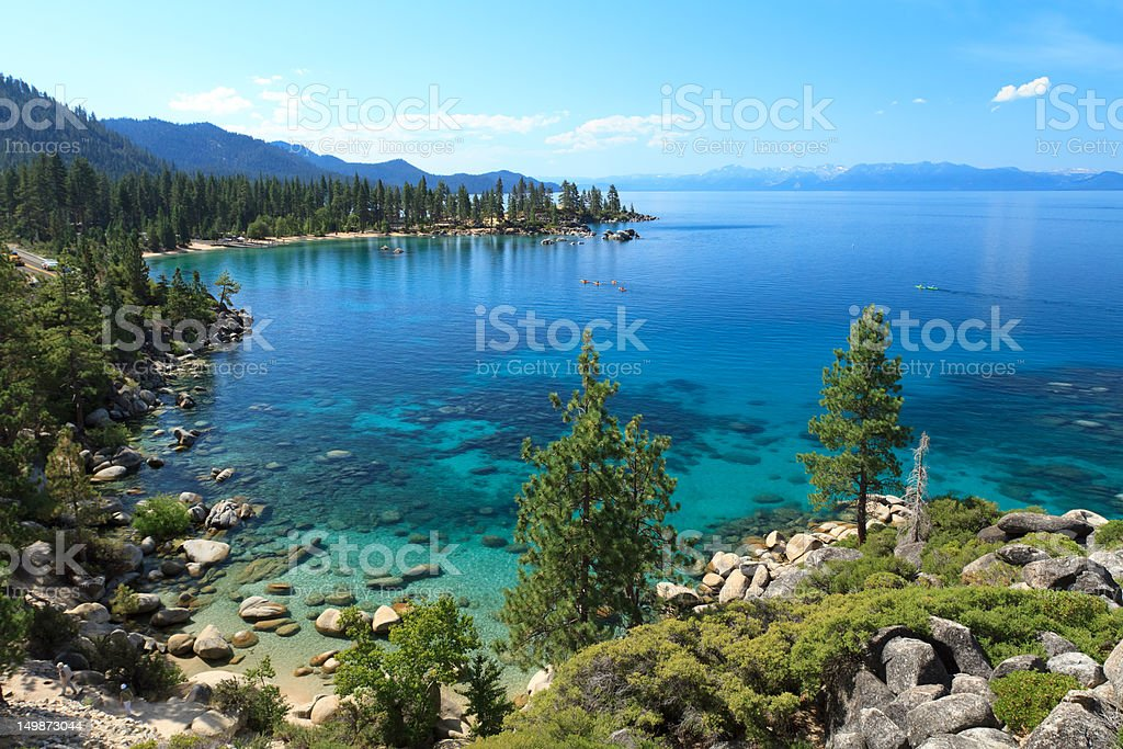 Lake Tahoe scene showing trees rocks and blue water royalty-free stock photo