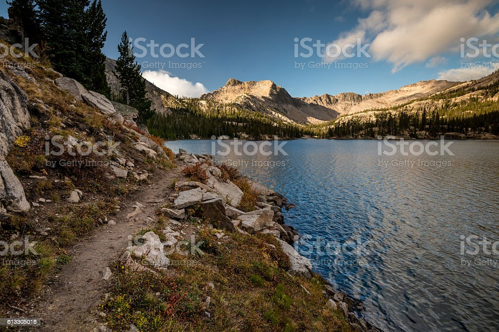 Lake trail leads its perimeter in morning stock photo