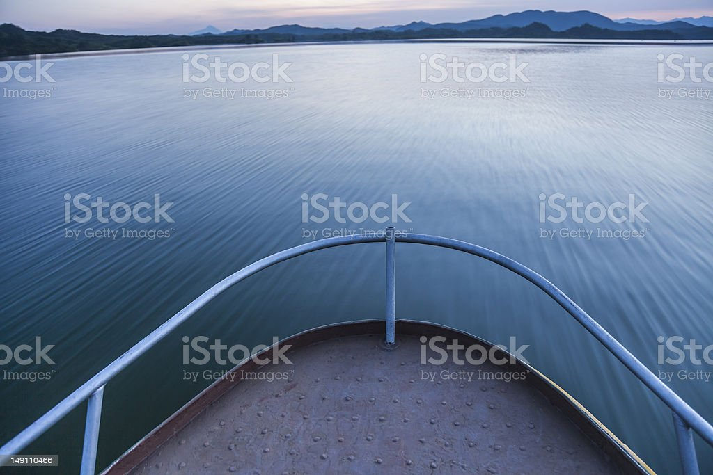 lake under sunset with motion blur stock photo