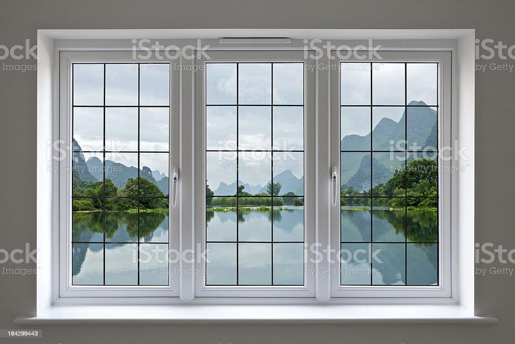 lake view through white windows royalty-free stock photo