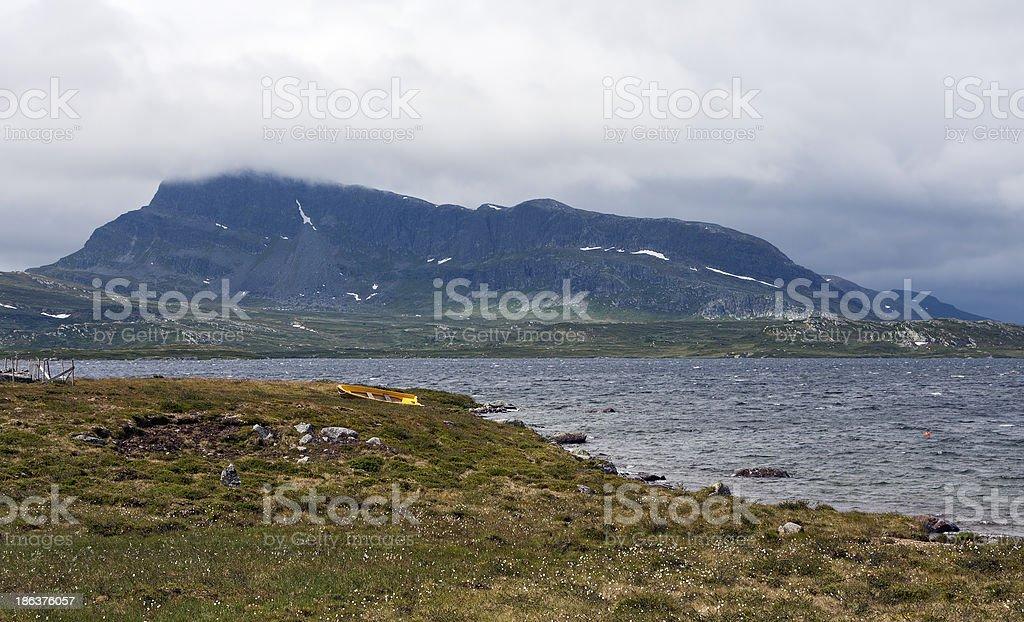Lake Vinstre and mountain Bitihorn (Jotunheimen, Norway) stock photo