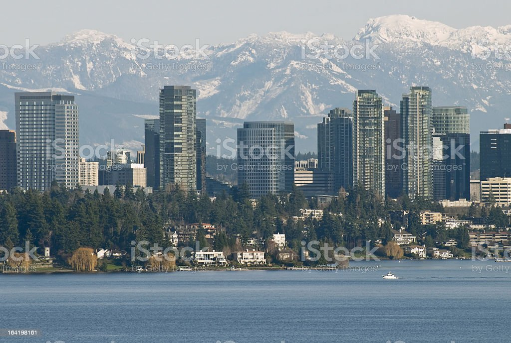 Lake Washington and city of Bellevue with mountain range behind stock photo