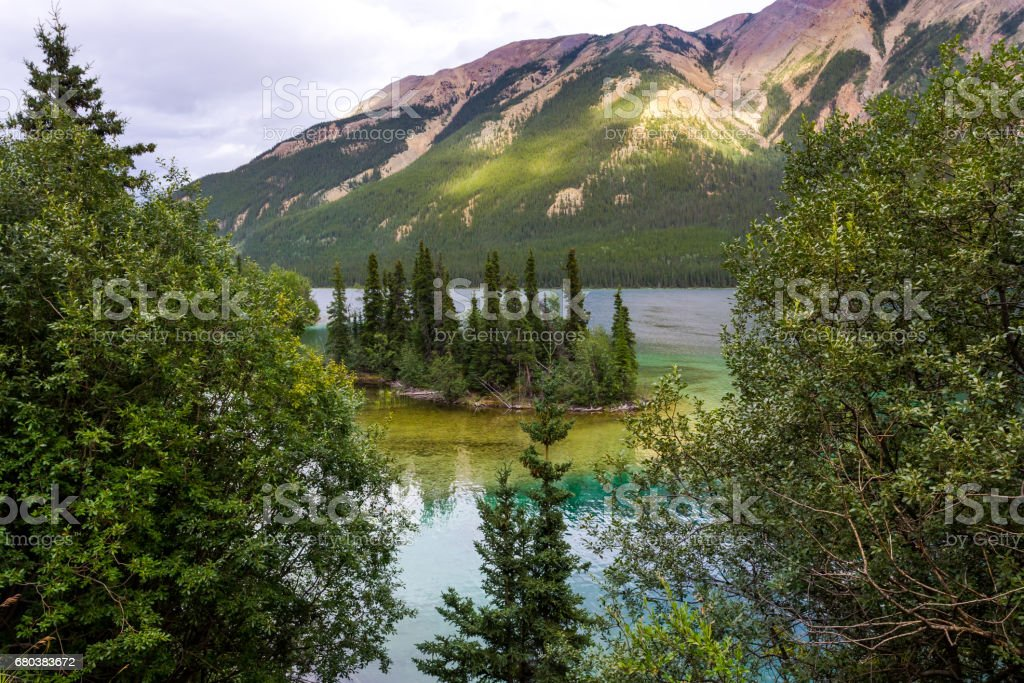 Lake with clear turquoise water stock photo