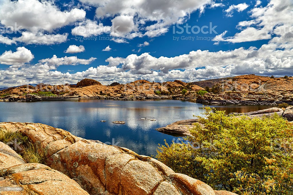 Lake with Dam in Boulders stock photo