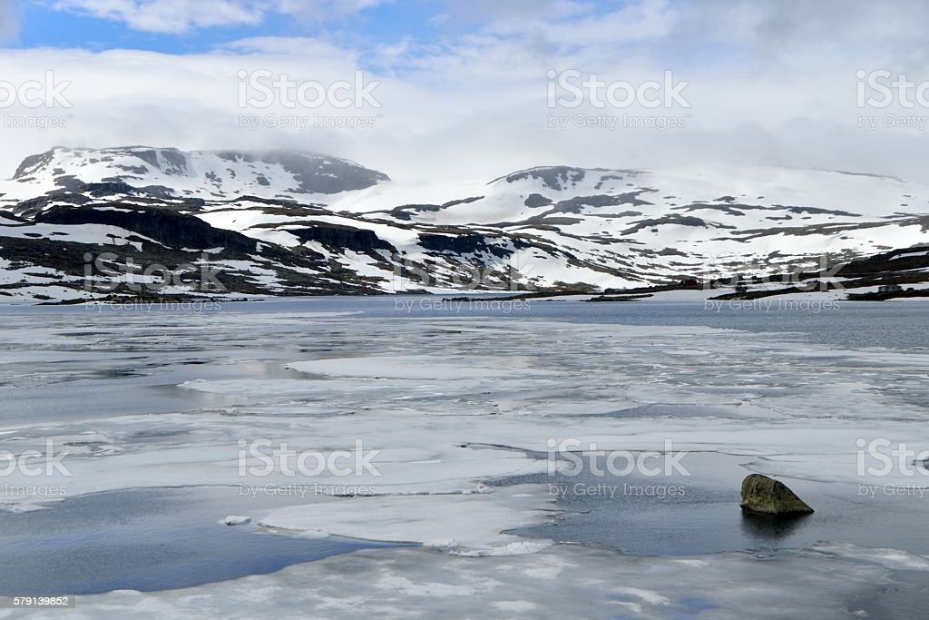 Lake with ice in Norweigian highlands stock photo