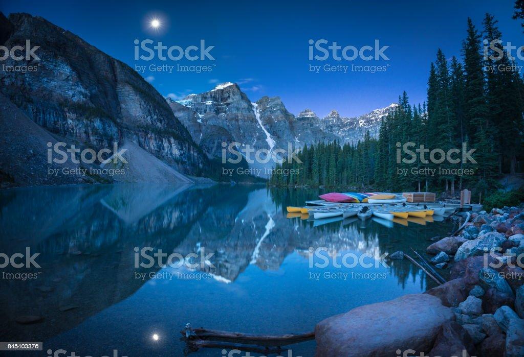 Lake with moon at 4:10AM stock photo