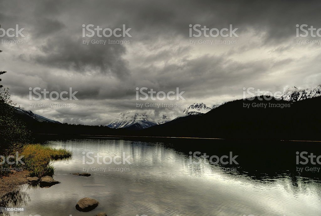Lake with pine and mountain in background royalty-free stock photo