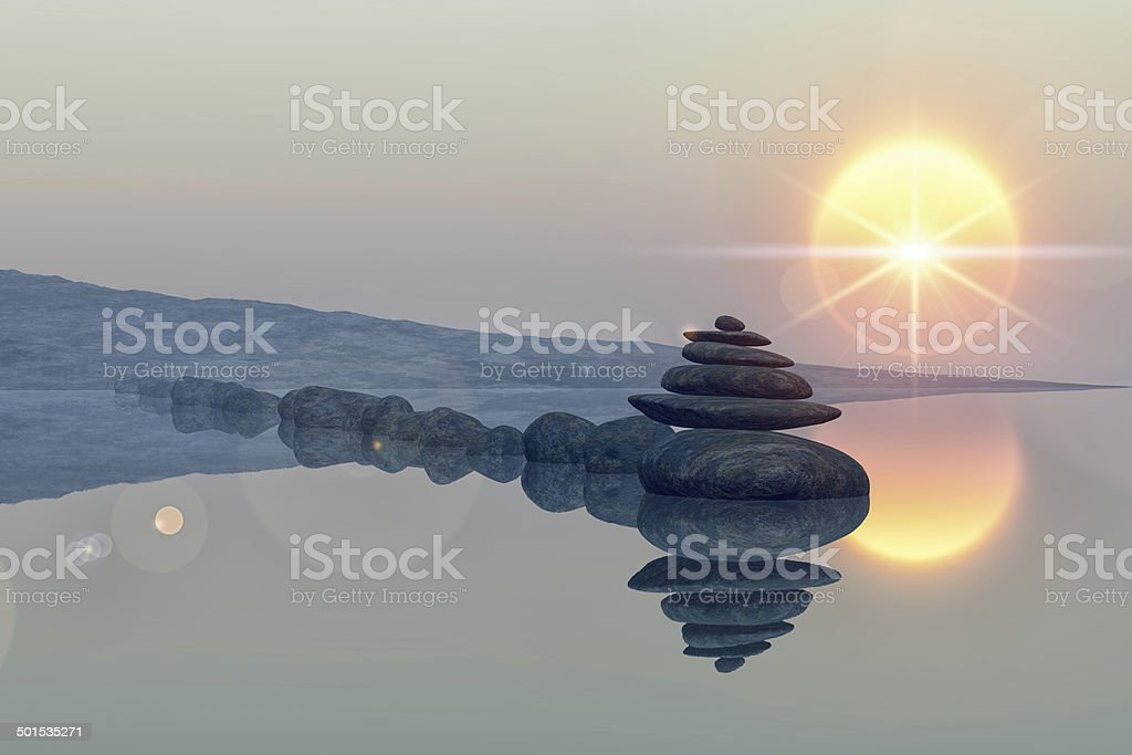 lake with stacked stones stock photo