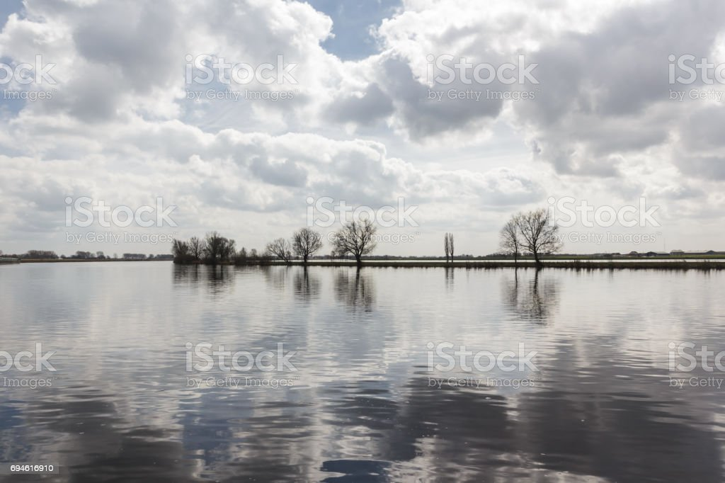 Lake with trees and sky reflection around Giethoorn, Holland, Netherlands stock photo