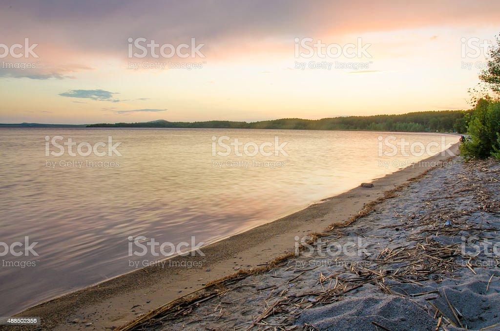 lakeshore landscape sunset stock photo