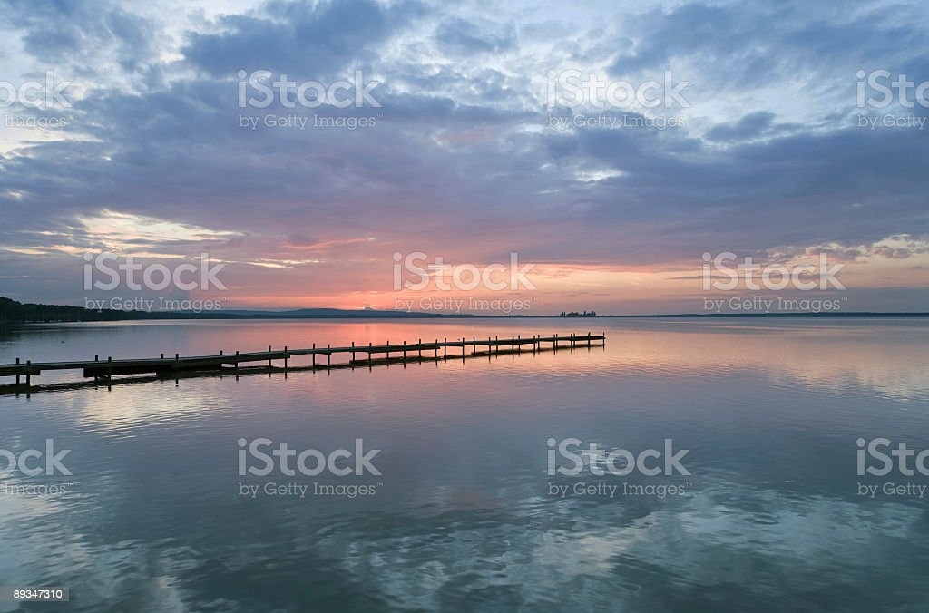 Lakeside jetty and majestic cloudscape at sunset (XXL) royalty-free stock photo