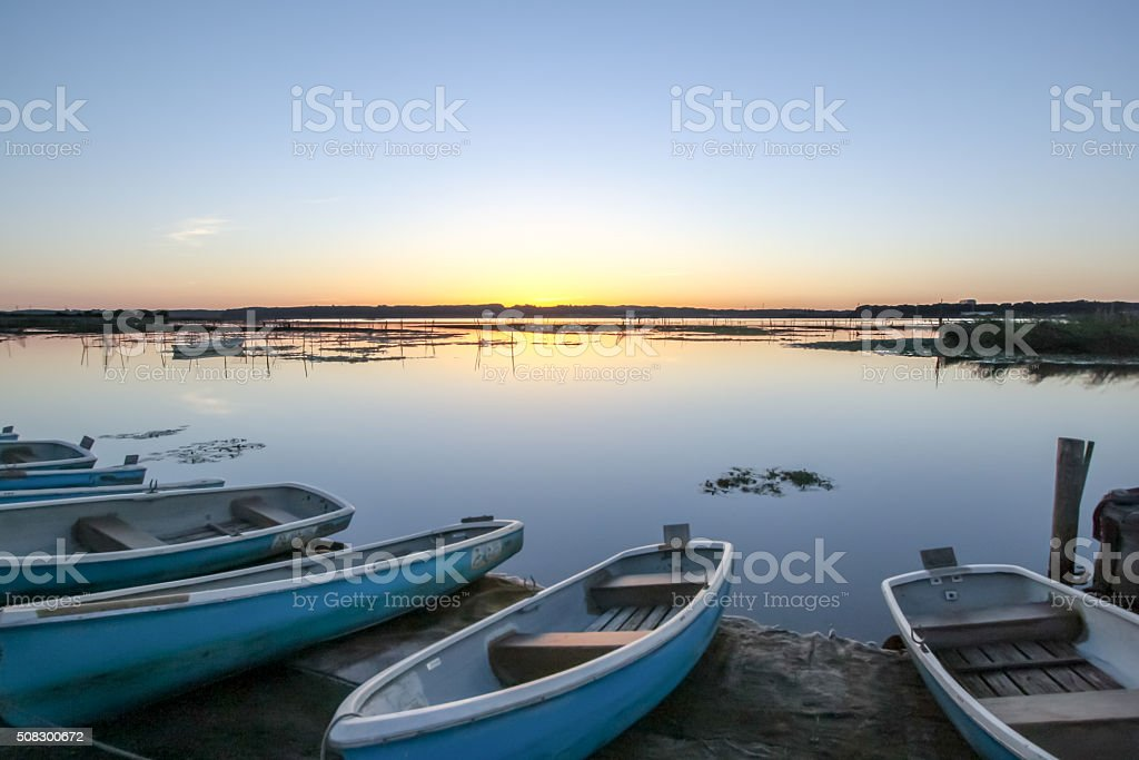 Lakeside sunrise stock photo